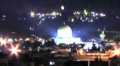 Big white thing hovering over bigger white dome shaped thing