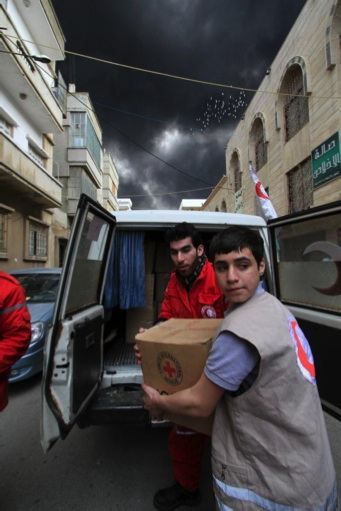 Humanitarian aid delivery in Homs- Baba Amr by Ibrahim Malla