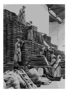 Women workers stacking oil cakes at an Oil and Cake factory Lancashire 1918 - Women and Industry at IWM North