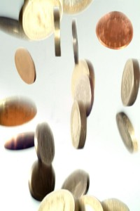 Falling coins by FreeFoto.com