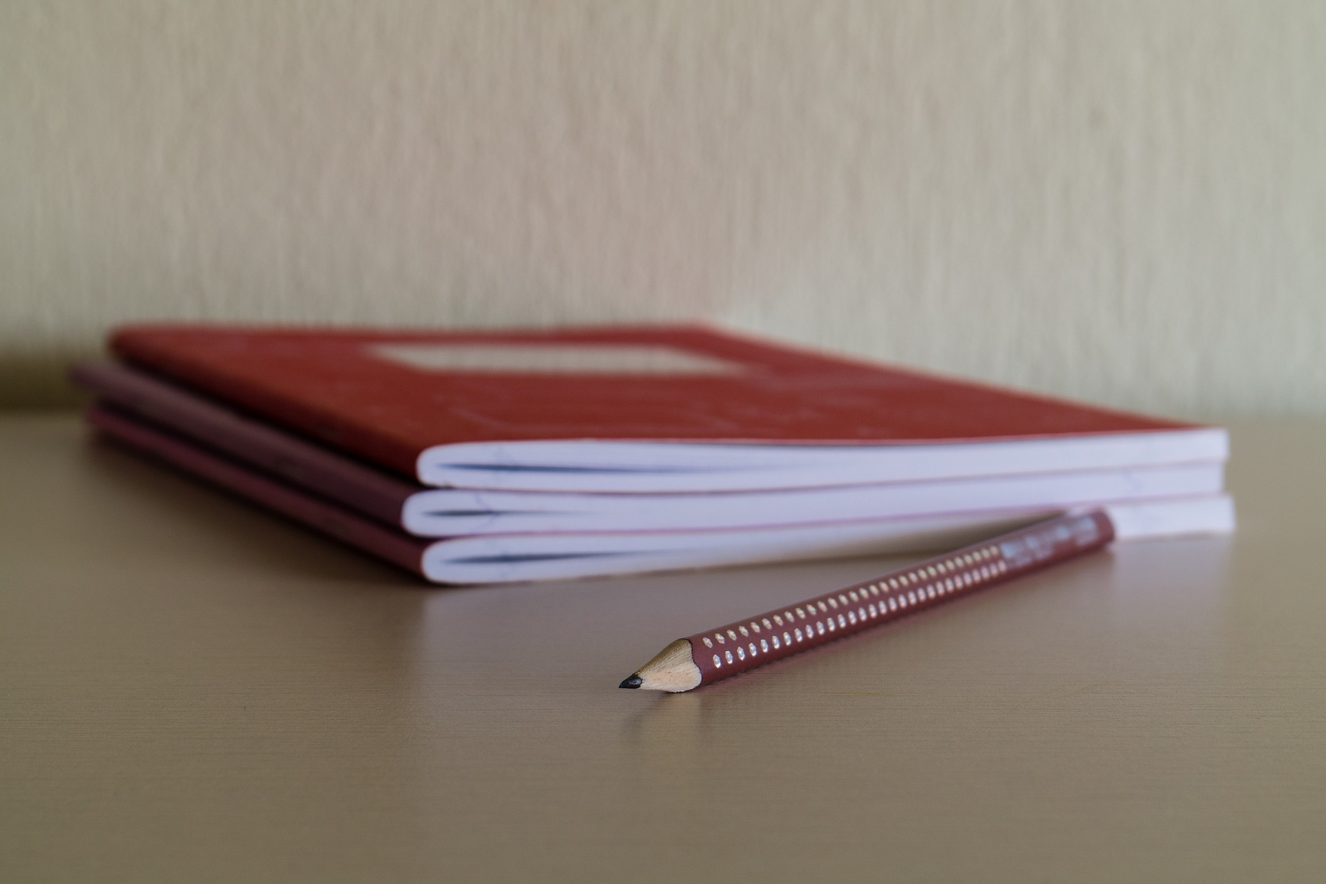 Notebooks and pencil (PD)