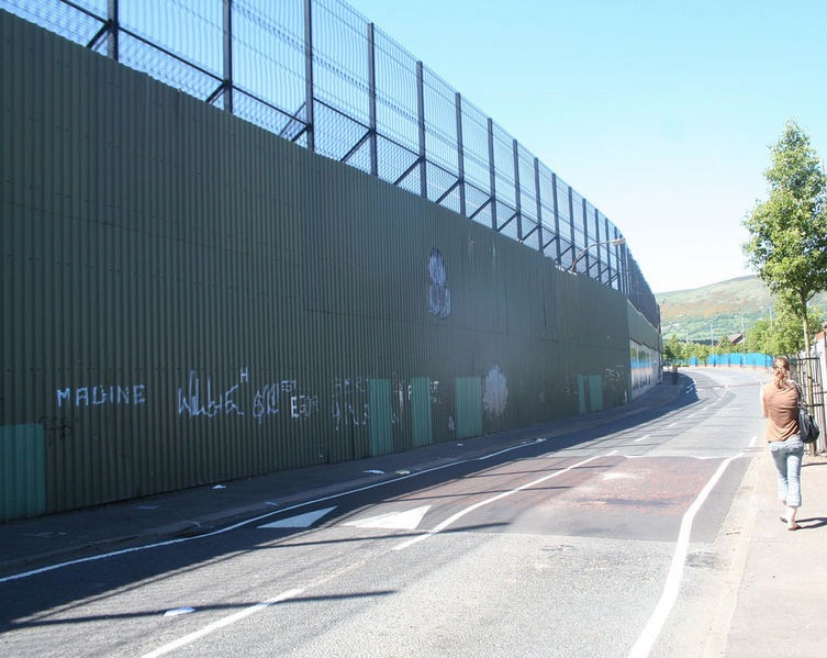 "The ""peace line"" or ""peace wall"" along Cupar Way:Cepar Way in Belfast, Northern Ireland (2010) by Duke Human Rights Center (CC-BY-2.0)"